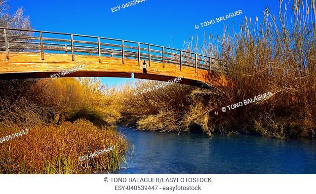 Autumn wooden bridge from Turia park of Guadalaviar river in Valencia province of Spain