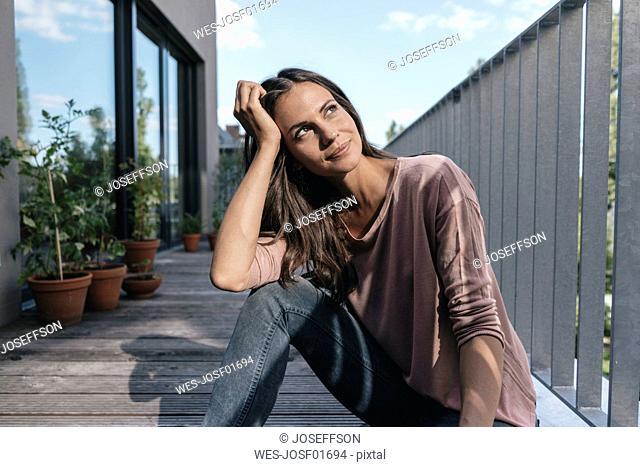 Woman relaxing on balcony