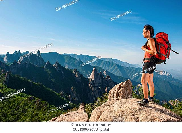 Female hiker looking out from ridge at Seoraksan National park, Gangwon, South Korea