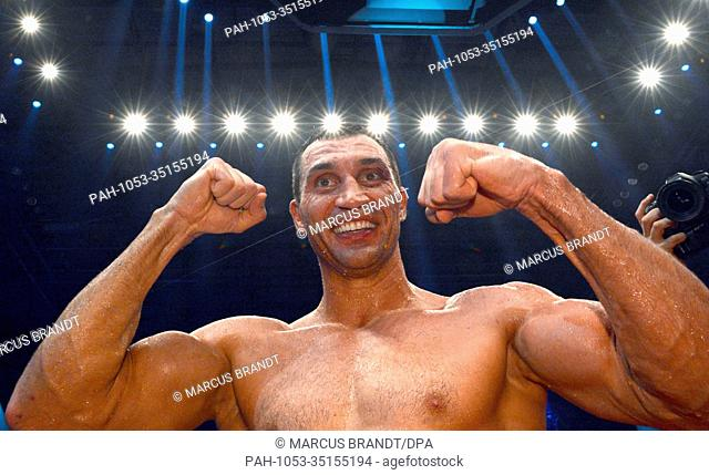 The old and new IBF, WBO, WBA and IBO heavyweightboxing world champion, Wladimir Klitschko (R), celebrates after his victory obver his Polish challenger Wach...