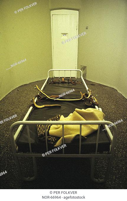 A bed in a cell