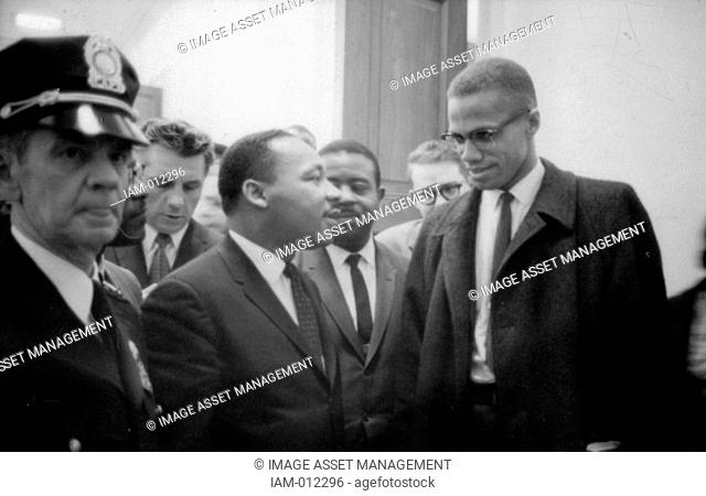 Martin Luther King Jnr 1929-1968 and Malcolm X Malcolm Little - 1925-1965 waiting for a press conference, 26 March 1964. Photographer: Marion S
