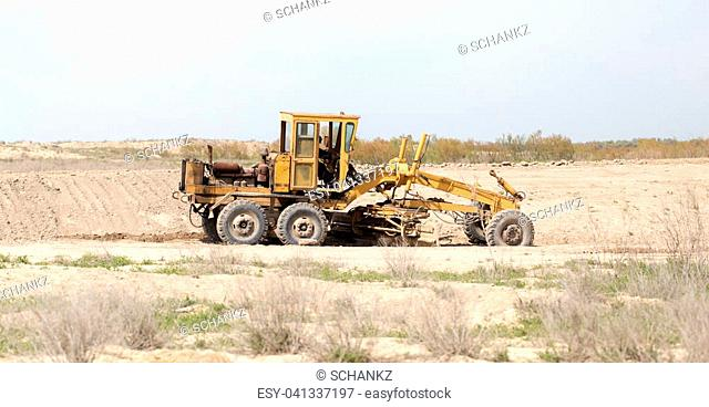 tractor to level the ground for the road