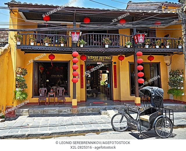 Facade of the Vinh Hung Hotel in Hoi An Ancient Town. Quang Nam Province, Vietnam