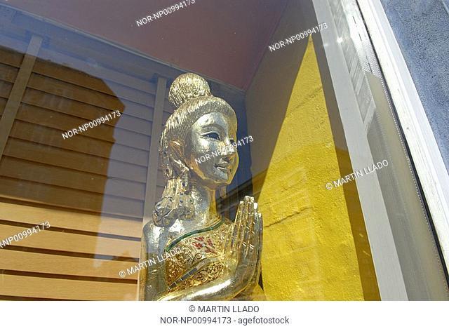 Golden goddess in praying pose, Copenhagen, Denmark