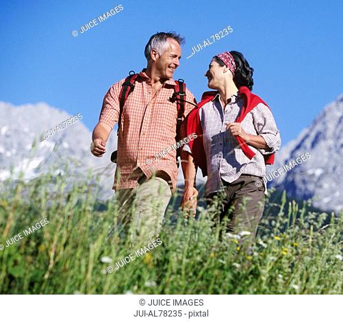 Couple holding hands in hills in Germany
