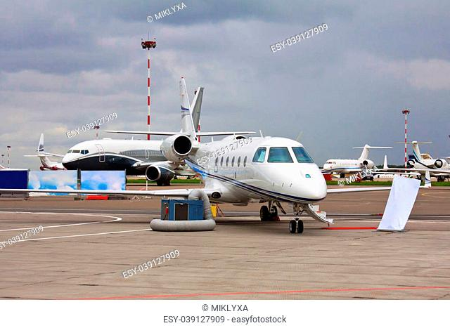 private jet with two engines on the background of a sky in cloudy weather