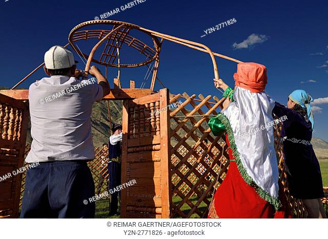 Saty villagers putting up a Yurt in Chilik river valley Kazakhstan