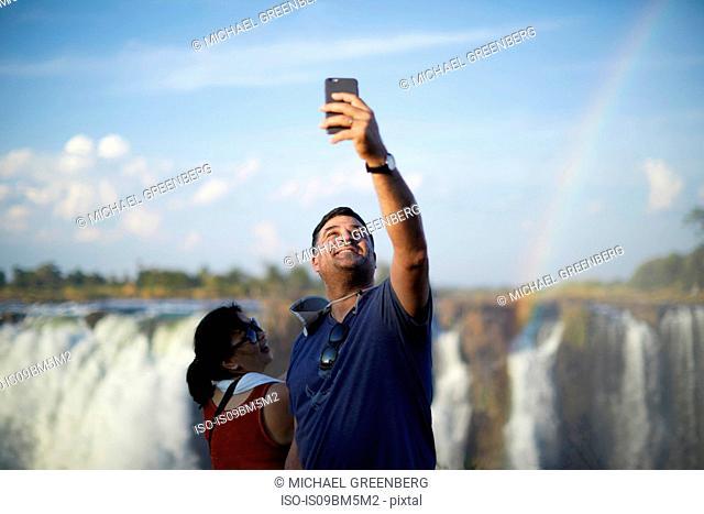 Tourists taking selfie, Victoria Falls, Zimbabwe
