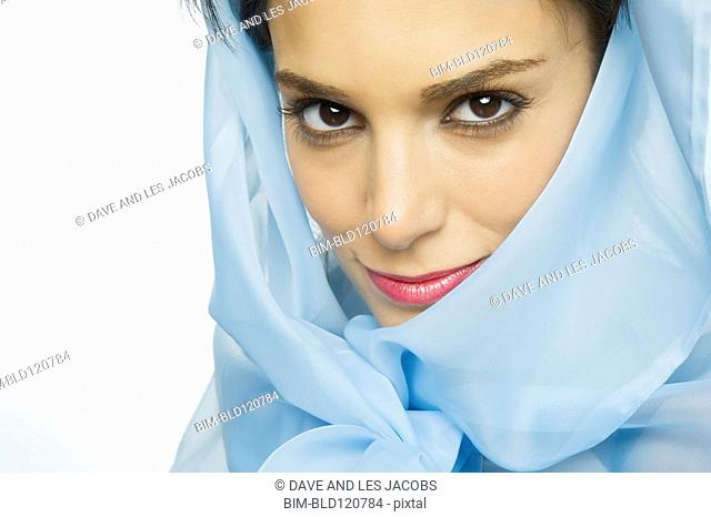 Middle Eastern woman wearing blue veil