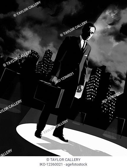 Furtive businessman under spotlight in financial district at night
