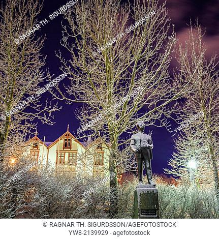 Statue of Olafur Thors and snow covered trees, Reykjavik, Iceland