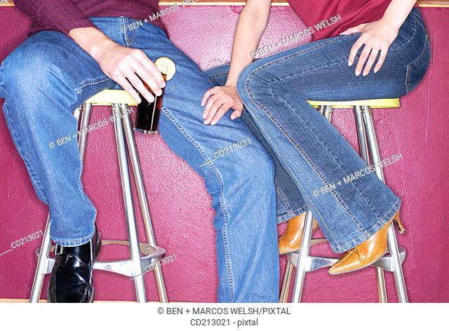 Couple in a bar (waist-down)