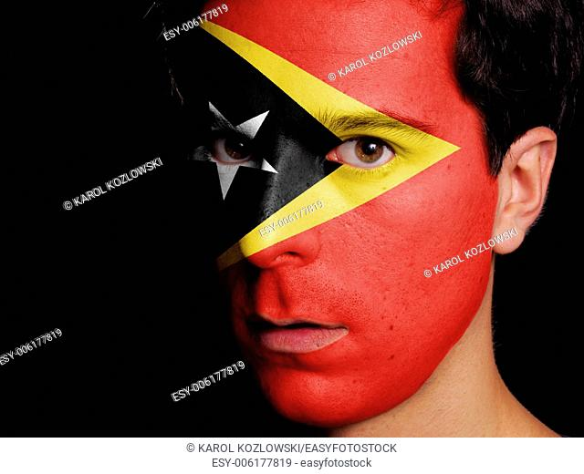 Flag of East Timor Painted on a Face of a Young Man