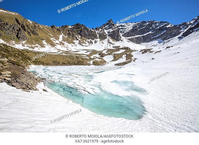 The spring thaw reveals the turquoise water of Laj dal Teo Poschiavo Valley Canton of Graubunden Switzerland Europe