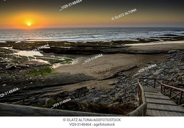 Sunset on Empa Beach, Ericeira. Stairs to the beach at Praia do Empa, Portugal
