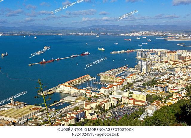 Gibraltar: Gibraltar town foreground with bay of Algeciras, Spain background U K