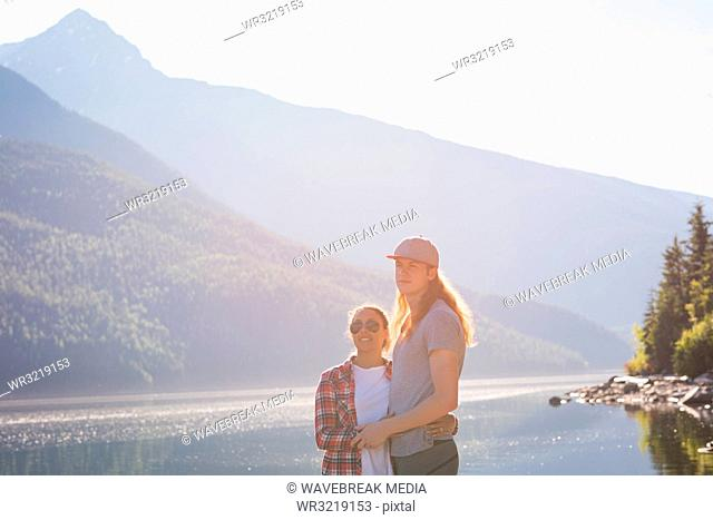 Couple standing near riverside
