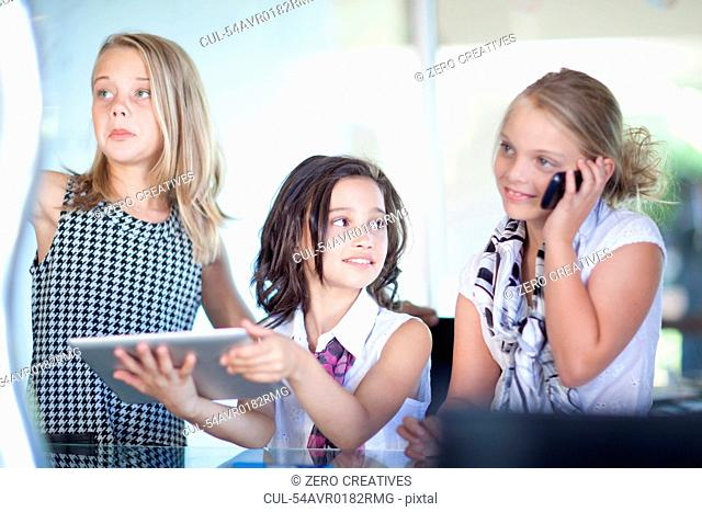 Girls playing businesswomen at desk