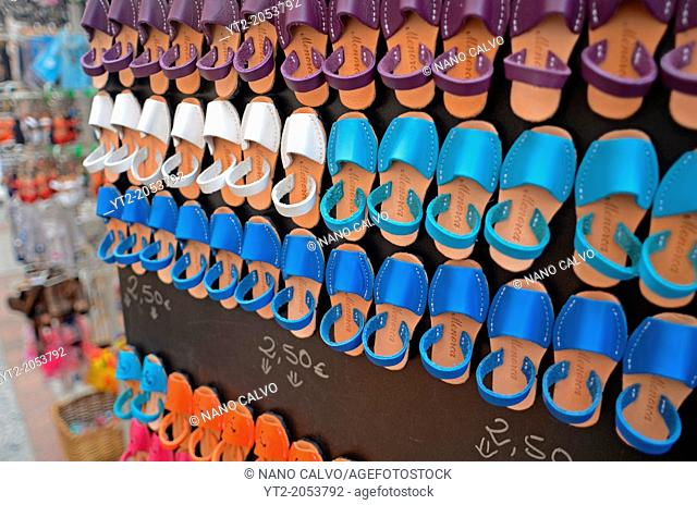 Fridge magnets with the shape of abarcas Menorquinas, traditional shoes from Menorca. Old Quarter in Ciudatella