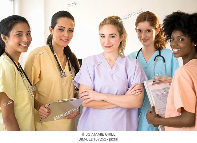 Nurses in colorful scrubs talking in hospital