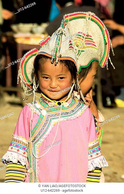 one girl have traditional clothes in the Yuanyang festival ,Yunnan ,China