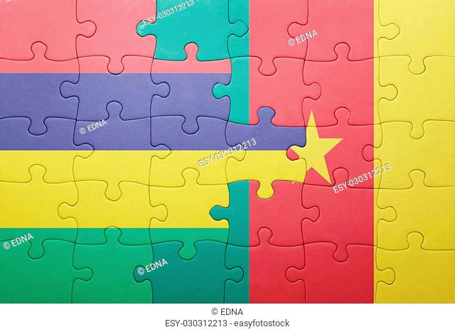 puzzle with the national flag of mauritius and cameroon . concept