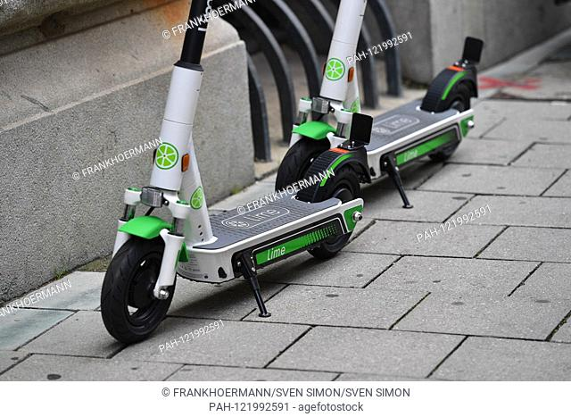 Electric scooter rent Stock Photos and Images | age fotostock
