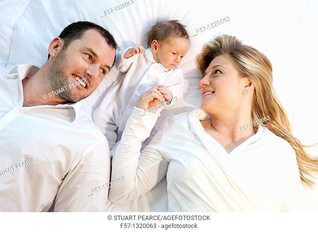 Three week old baby boy with parents