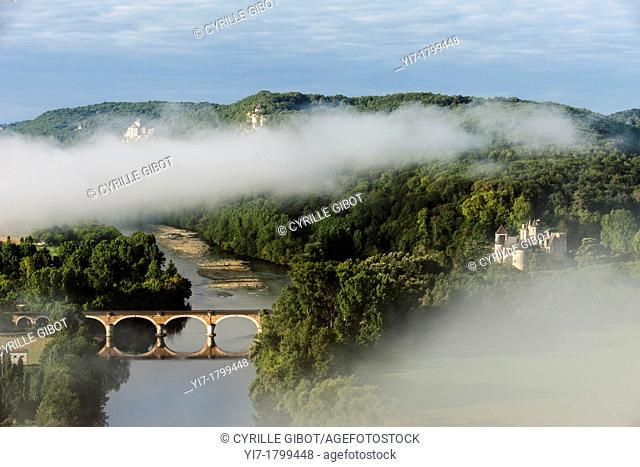 The Dordogne river and the Fayrac castle, Dordogne, Aquitaine, France. The Castelnaud castle is visible in the distance on the left hand side