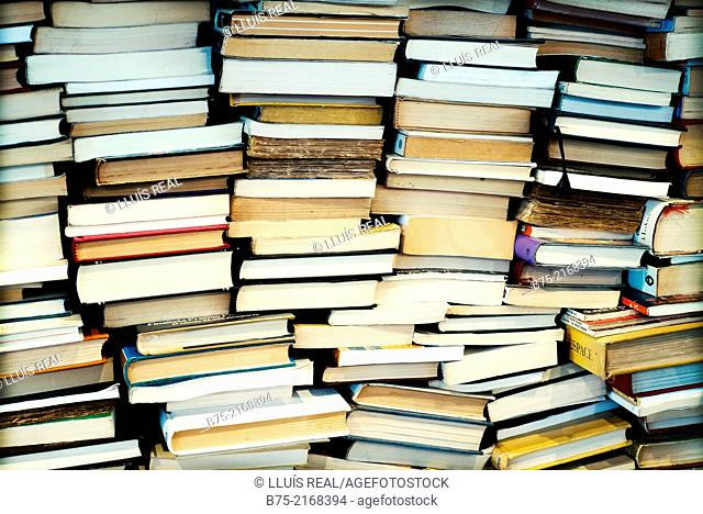 Closeup of used books stacked in a book shop in Els Encants market in Barcelona, Spain, Europe