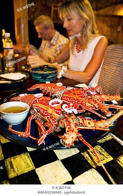 tourists in a restaurant eating cryfish, India, Andaman Islands