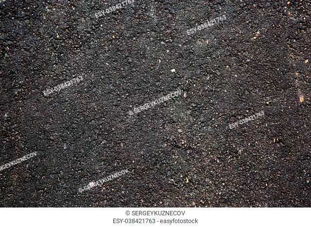 Dark asphalt surface, background. Texture. pattern of road