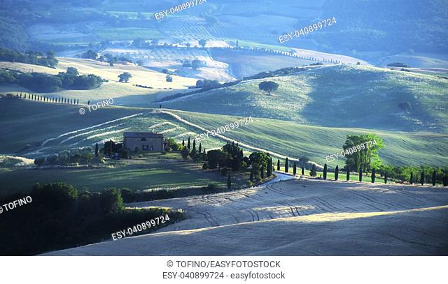 VAL D'ORCIA, ITALY - JUNE 11, 2017: Landscape view of Val d'Orcia, Tuscany, Italy. UNESCO World Heritage Site