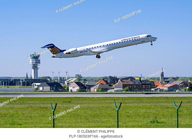 Bombardier CRJ-900LR, regional jet airliner from Lufthansa CityLine taking off from runway at Brussels Airport, Zaventem, Belgium