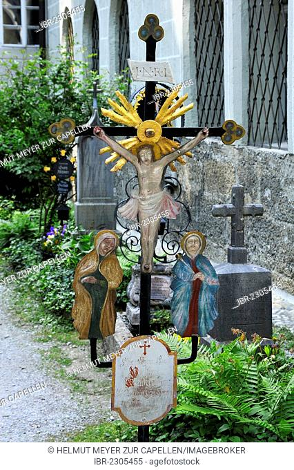 Old colourful wrought-iron cross on a grave, St. Peter's Cemetery, the oldest Christian burial site of Salzburg, St. Peter's district, Salzburg