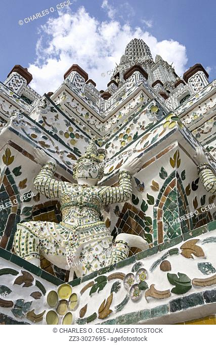 Bangkok, Thailand. Wat Arun Architectural Detail, Mythical Demon (Yaksha) Supporting the Structure