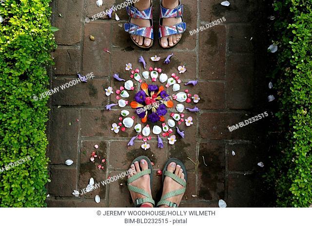 Feet of woman near arranged flowers