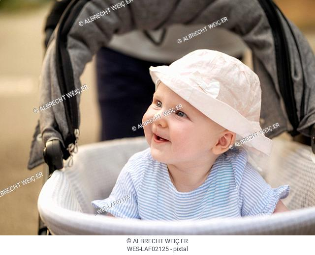 Portrait of relaxed baby girl in pram