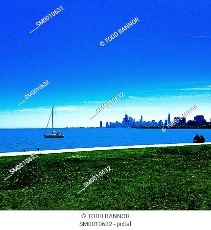 Lake Michigan, sailboat and downtown Chicago viewed from Montrose Point