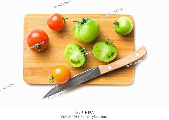 tomatoes on cutting board