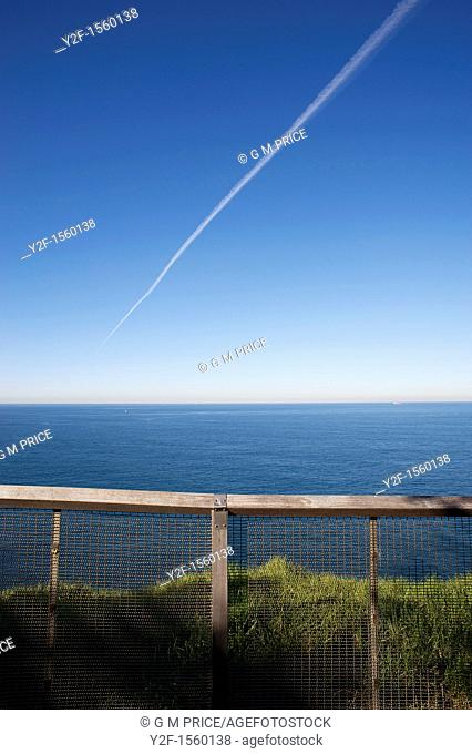contrail and fence at Dover Heights, Sydney