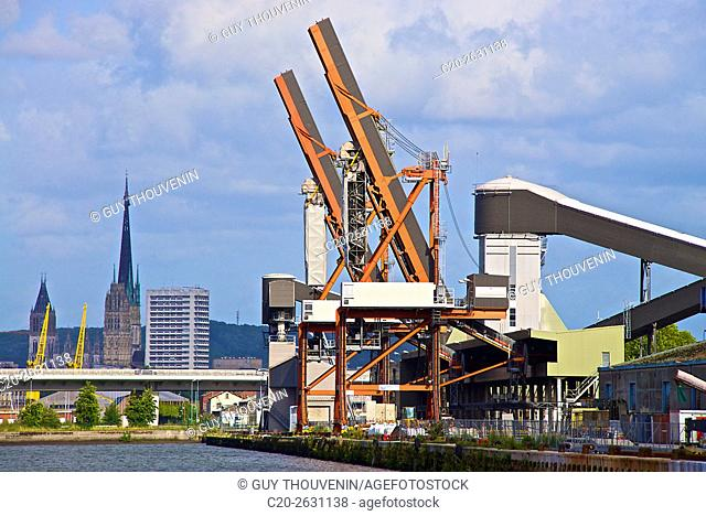 Grain fodder silos and cranes with Notre Dame cathedral in the background, Rouen Cereal harbor, Rouen, 76, Normandy, France