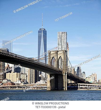 View of suspension bridge and cityscape