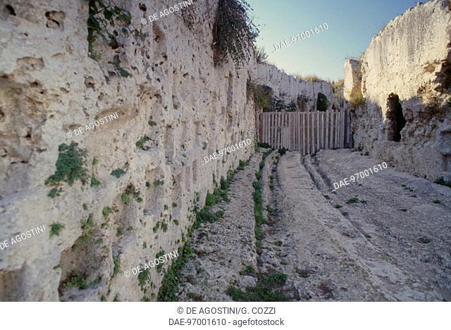 Votive grooves in Via dei Sepolcri, Neapolis Archaeological Park, Syracuse (UNESCO World Heritage Site, 2005), Sicily, Italy, Magna Graecia civilization