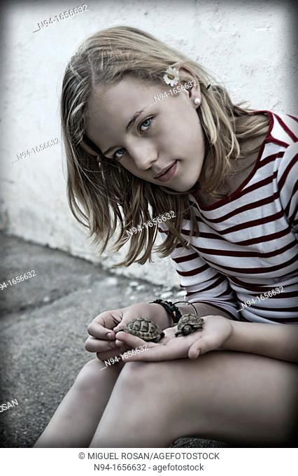 Teenage girl with hand pet turtle