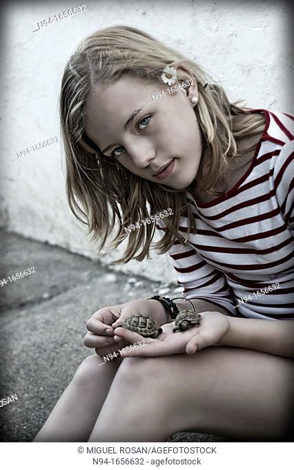Teenage girl with hand pet turtle