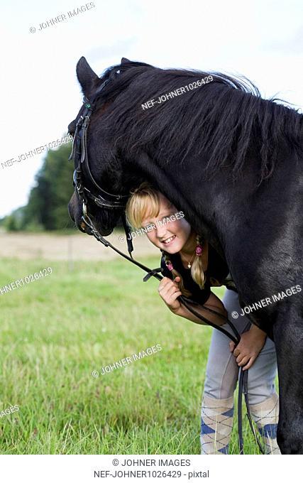 England, Cornwall, Dartmoor, portrait of girl (10-11) with horse