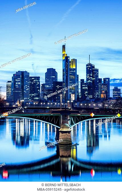 Frankfurt on the Main, Hessia, Germany, view to the skyline and the financial district with Ignaz-Bubis bridge in the dusk