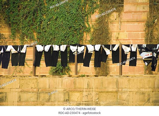 Trousers hanging to dry, on the ghats, Varanasi, Benares, Uttar Pradesh, India